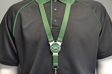 Printed and domed lanyards - Circle lanyard with a green strap | www.namebadgesinternational.co.uk